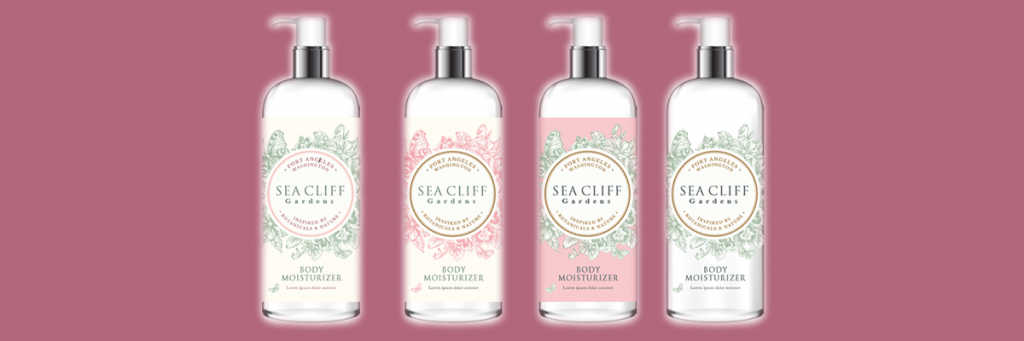 Picture of four lotion bottles with Sea Cliff Gardens' logo on the front