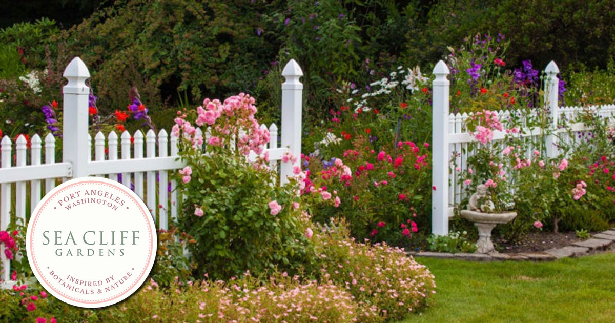 Picture of Sea Cliff Gardens - Lawn with white fence and flowers